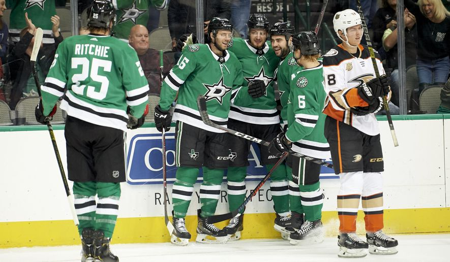 Dallas Stars center Jason Dickinson (16) celebrates with teammates after scoring a goal against the Anaheim Ducks during the first period of an NHL hockey game, Thursday, Oct. 25, 2018, in Dallas. (AP Photo/Cooper Neill)