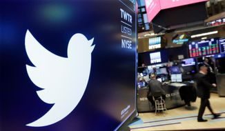 In this Feb. 8, 2018, photo, the logo for Twitter is displayed above a trading post on the floor of the New York Stock Exchange. (AP Photo/Richard Drew) **FILE**