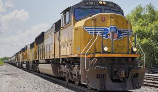 FILE- In this July 31, 2018, file photo a Union Pacific train travels through Union, Neb. Union Pacific Corp. reports earnings Thursday, Oct. 25. (AP Photo/Nati Harnik, File)