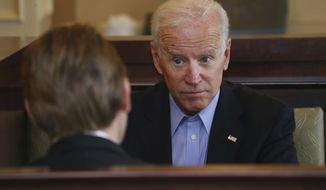 Former Vice President Joe Biden talks with 27th Congressional District Democratic candidate Nate McMurray after greeting workers and patrons in a restaurant, Thursday, Oct. 25, 2018, in Lancaster N.Y. (AP Photo/Jeffrey T. Barnes) ** FILE **