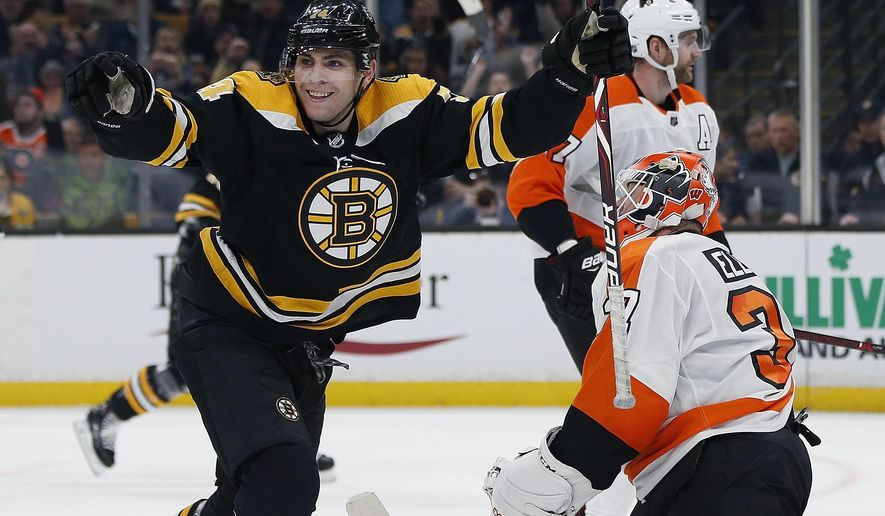 Boston Bruins' Jake DeBrusk (74) celebrates his goal against Philadelphia Flyers' Brian Elliott (37) during the second period of an NHL hockey game in Boston, Thursday, Oct. 25, 2018. (AP Photo/Michael Dwyer)