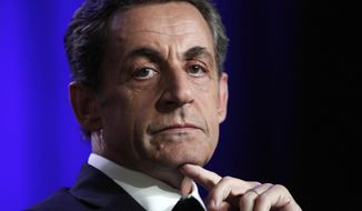 FILE - In this March 24 2015 file photo, former French President Nicolas Sarkozy attends a meeting in Asnieres, outside Paris. Sarkozy has lost an appeal against an earlier legal decision and could stand trial on charges of illegally financing his 2012 presidential campaign. (AP Photo/Thibault Camus, File)