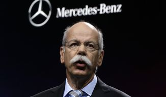 FILE - In this Jan. 14, 2013 file photo Dieter Zetsche, Chairman of the Board of Management of Daimler AG, Head of Mercedes-Benz Cars speaks at media previews for the North American International Auto Show in Detroit. Automaker Daimler, maker of Mercedes-Benz cars, announces third quarter earnings Thursday, Oct. 25, 2018. (AP Photo/Paul Sancya, file)