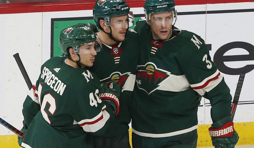 Minnesota Wild's Jared Spurgeon, left, and Charlie Coyle, right, congratulate Jonas Brodin on his goal off Los Angeles Kings goalie Jack Campbell in the second period of an NHL hockey game Thursday, Oct. 25, 2018, in St. Paul, Minn. (AP Photo/Jim Mone)