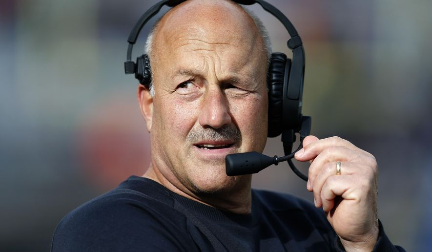 Boston College head coach Steve Addazio talks on his headset during the second half of an NCAA college football game against Louisville in Boston, Saturday, Oct. 13, 2018. (AP Photo/Michael Dwyer)