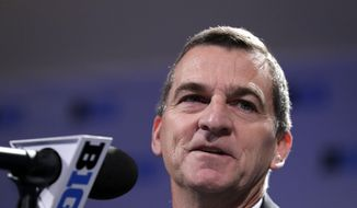 FILE - In this Oct. 11, 2018, file photo, Maryland head coach Mark Turgeon smiles as he speaks at a press conference during Big Ten NCAA college basketball media day, in Rosemont, Ill. Turgeon hopes youthful exuberance will be more important than experience and senior leadership in his effort to get the Terrapins back into the NCAA Tournament. (AP Photo/Nam Y. Huh, File) **FILE**