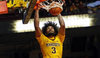 FILE - In this Jan. 3, 2018, file photo, Minnesota's Jordan Murphy dunks against Illinois' in the second half of an NCAA college basketball game, in Minneapolis. Coming off an injury-ravaged season with a 15-17 record, Minnesota is primed for a bounce back in coach Richard Pitino's sixth year with a strong class of newcomers and one of the Big Ten's best big men in Jordan Murphy. (AP Photo/Jim Mone, File)