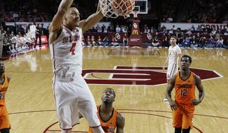 FILE - In this Wednesday, Jan. 3, 2018 file photo, Oklahoma center Jamuni McNeace (4) dunks in the first half of an NCAA college basketball game against Oklahoma State in Norman, Okla. Now that Trae Young is gone to the NBA's Atlanta Hawks, Oklahoma has a giant hole to fill. (AP Photo/Sue Ogrocki, File)