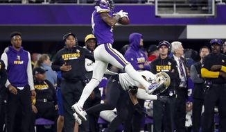 FILE - In this Jan. 14, 2018, file photo, Minnesota Vikings wide receiver Stefon Diggs (14) makes a catch over New Orleans Saints free safety Marcus Williams (43) on his way to the game winning touchdown during the second half of an NFL divisional football playoff game in Minneapolis. The Vikings defeated the Saints 29-24. The New Orleans Saints lost twice in Minnesota last season, none more crushing in the history of the franchise than in the playoffs on the last-second touchdown pass by the Vikings.(AP Photo/Jeff Roberson, File)