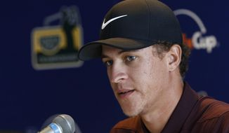 Cameron Champ, first day leader of the Sanderson Farms Championship golf tournament in Jackson, Miss., Thursday, Oct. 25, 2018, speaks about his play on the Country Club of Jackson course, during a post play news conference. (AP Photo/Rogelio V. Solis)