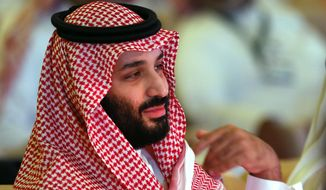 Saudi Crown Prince, Mohammed bin Salman attends the second day of the Future Investment Initiative conference, in Riyadh, Saudi Arabia, Wednesday, Oct. 24, 2018. The powerful crown prince spoke at the Riyadh investment forum clouded by Jamal Khashoggi's killing. (AP Photo/Amr Nabil) ** FILE **