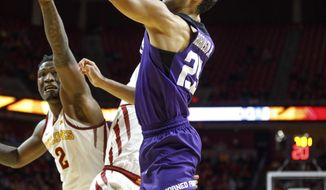 """FILE - In this Feb. 21, 2018, file photo, TCU's Alex Robinson (25) shoots around Iowa State's Donovan Jackson (4) and Cameron Lard (2) during the second half of an NCAA college basketball game, in Ames, Iowa. The Horned Frogs are coming off their first NCAA Tournament appearance in 20 seasons. They must deal with the departures of their top two scorers _ Vladimir Brodzianski and Kenrich Williams. Plus, point guard Jaylen Fisher, one of the returners, is injured again. """"It was a big adjustment. Kenrich did a lot for us, and Vlad did a lot for us,"""" senior guard Alex Robinson said. (AP Photo/Scott Morgan, File)"""