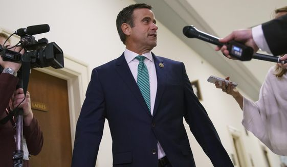 Rep. John Ratcliffe, R-Texas., speaks to media, on Capitol Hill in Washington, Thursday, Oct. 25, 2018. George Papadopoulos, the former Trump campaign adviser who triggered the Russia investigation, will speak behind closed doors to two GOP-led House committees that are investigating partisan bias at the Justice Department. (AP Photo/Carolyn Kaster)