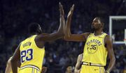 Golden State Warriors' Kevin Durant, right, celebrates a score against the Washington Wizards with Draymond Green (23) during the first half of an NBA basketball game, Wednesday, Oct. 24, 2018, in Oakland, Calif. (AP Photo/Ben Margot) **FILE**