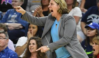 FILE - In this July 5, 2018, file photo, Minnesota Lynx coach Cheryl Reeve argues a call with an official during the second half of the team's WNBA basketball game against the Los Angeles Sparks, in Minneapolis. The WNBA continues to lead all professional sports leagues in hiring women and minorities for coaching and front-office positions. The league earned an overall A-plus grade as well as A-pluses for racial and gender diversity in its hiring practices, according to a report card issued Thursday, Oct. 5, 2018, by The Institute for Diversity and Ethics in Sports (TIDES).(Aaron Lavinsky/Star Tribune via AP, File)