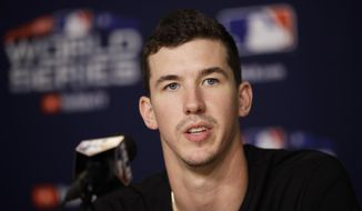 Los Angeles Dodgers starting pitcher Walker Buehler speaks during a baseball news conference, Thursday, Oct. 25, 2018, in Los Angeles, ahead of Friday's Game 3 of the team's World Series against the Boston Red Sox. (AP Photo/Jae C. Hong)