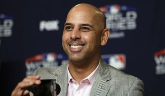 Boston Red Sox manager Alex Cora smiles while speaking at a baseball news conference, Thursday, Oct. 25, 2018, in Los Angeles, ahead of Friday's Game 3 of the team's World Series against the Los Angeles Dodgers. (AP Photo/Jae C. Hong)