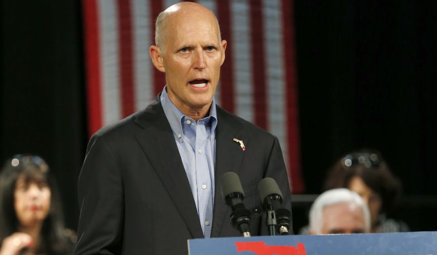 In this July 13, 2018, file photo, Florida Gov. Rick Scott, speaks to Cuban-American supporters at a campaign stop, in Hialeah, Fla. Scott is getting back on the campaign trail after spending more than two weeks dealing with the aftermath of Hurricane Michael. Despite being embroiled in a tight race with U.S. Sen. Bill Nelson, Scott has spent most of his time in the Florida Panhandle counties damaged by the deadly storm.  (AP Photo/Wilfredo Lee, File)