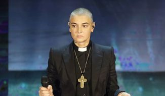 "In this Oct. 5, 2014, file photo, Irish singer Sinead O'Connor performs during the Italian State RAI TV program ""Che Tempo che Fa,"" in Milan, Italy. O'Connor, 51, has announced Friday Oct. 26, 2018, that she has converted to Islam and said she has changed her name to Shuhada' Davitt. (AP Photo/Antonio Calanni, File)"