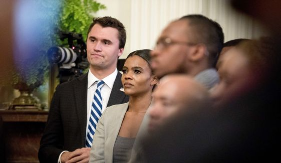 Conservative commentator and conservative advocacy group Turning Point USA Director of Communications Candace Owens, center, listens as President Donald Trump speaks at the 2018 Young Black Leadership Summit in the East Room of the White House, Friday, Oct. 26, 2018, in Washington. (AP Photo/Andrew Harnik)