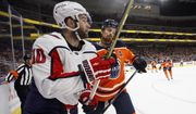 Washington Capitals' Brett Connolly (10) is checked by Edmonton Oilers' Adam Larsson (6) during the first period of an NHL hockey game, Thursday, Oct. 25, 2018, in Edmonton, Alberta. (Jason Franson/The Canadian Press via AP) ** FILE **