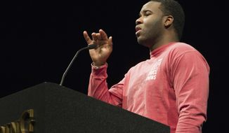 FILE - This March 24, 2014, file photo provided by Harding University in Searcy, Ark., shows Botham Jean, speaking at the university. The family of Jean, a 26-year-old man who was shot and killed in his own apartment by Amber Guyger, a white former Dallas police officer, filed a federal lawsuit on Friday, Oct. 26, 2018. (Jeff Montgomery/Harding University via AP, File)