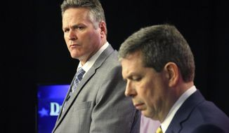 Alaska gubernatorial candidates Mike Dunleavy, left, a Republican, and Democrat Mark Begich, right, are shown prior to a debate Thursday, Oct. 25, 2018, in Anchorage, Alaska. They appeared for the debate after incumbent Gov. Bill Walker, an independent, dropped his campaign a week earlier. (AP Photo/Mark Thiessen)