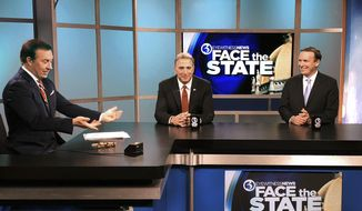 Dennis House, left, host of Face the State, speaks with Republican candidate Matt Corey and Democrat U.S. Sen. Chris Murphy before a debate Friday, Oct. 26, 2018, in the WFSB Channel 3 studio in Rocky Hill, Conn. Corey is challenging Murphy in the November general election. (AP Photo/Susan Haigh)
