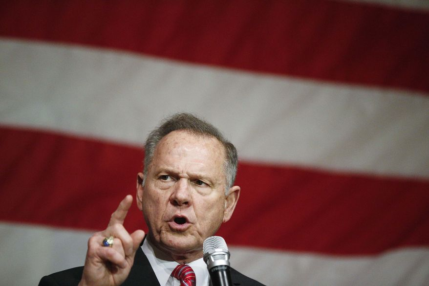 In this Tuesday, Dec. 5, 2017 file photo, former Alabama Chief Justice and U.S. Senate candidate Roy Moore speaks at a campaign rally, in Fairhope Ala.  (AP Photo/Brynn Anderson, File) **FILE**
