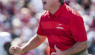 FILE - In this Sept. 8, 2018, file photo, Georgia head coach Kirby Smart yells before an NCAA college football game against South Carolina, in Columbia, S.C. No. 9 Florida and No. 7 Georgia play in Jacksonville, Fla., Saturday, Oct. 27. (AP Photo/Sean Rayford, File)