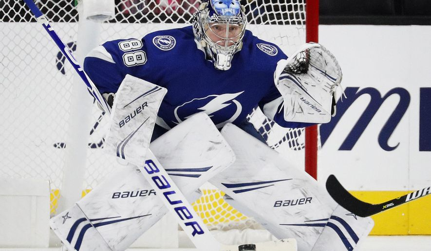 Tampa Bay Lightning goaltender Andrei Vasilevskiy (88) blocks a shot by the Vegas Golden Knights during the third period of an NHL hockey game Friday, Oct. 26, 2018, in Las Vegas. (AP Photo/John Locher)