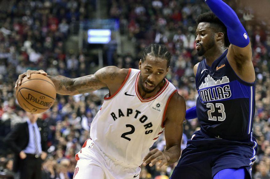Toronto Raptors forward Kawhi Leonard (2) drives to the net against Dallas Mavericks guard Wesley Matthews (23) during the first half of an NBA basketball game, Friday, Oct. 26, 2018 in Toronto. (Frank Gunn/The Canadian Press via AP)