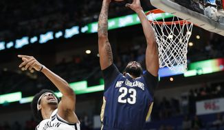 New Orleans Pelicans forward Anthony Davis (23) goes to the basket against Brooklyn Nets center Jarrett Allen (31) in the first half of an NBA basketball game in New Orleans, Friday, Oct. 26, 2018. (AP Photo/Gerald Herbert)