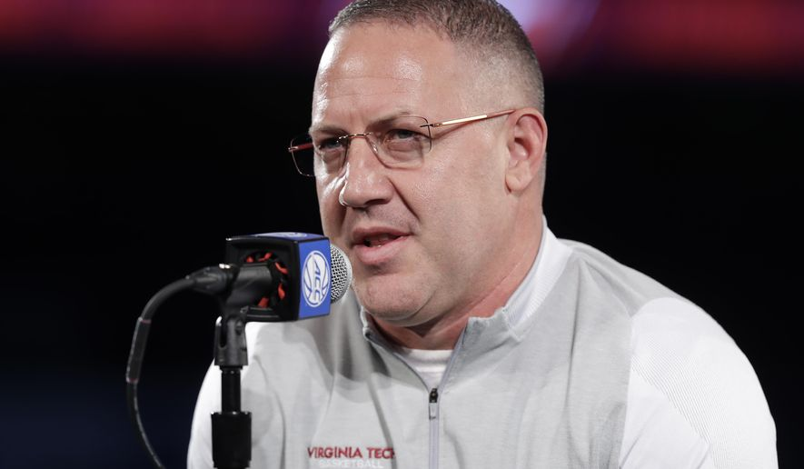 FILE - In this Oct. 24, 2018, file photo, Virginia Tech head coach Buzz Williams speaks to the media during a news conference at the Atlantic Coast Conference NCAA college basketball media day, in Charlotte, N.C. Virginia Tech opens the season against Gardner-Webb on Nov. 9.  (AP Photo/Chuck Burton, File)