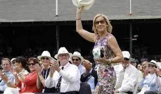 FILE - In this July 22, 2017, file photo, Tennis Hall of Famer Chris Evert waves to applause as she arrives at the International Tennis Hall of Fame in Newport, R.I. The Women's Tennis Association has dedicated its trophy for the top-ranked player of the year in honor of Chris Evert. (AP Photo/Elise Amendola, File)