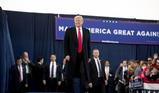 President Donald Trump arrives for a rally at Southern Illinois Airport in Murphysboro, Ill., Saturday, Oct. 27, 2018. (AP Photo/Andrew Harnik)