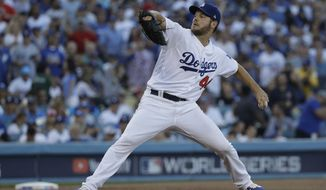 Los Angeles Dodgers pitcher Rich Hill throws during the first inning in Game 4 of the World Series baseball game against the Boston Red Sox on Saturday, Oct. 27, 2018, in Los Angeles. (AP Photo/David J. Phillip) ** FILE **
