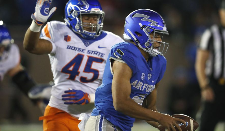 Air Force quarterback Isaiah Sanders runs for a short gain as Boise State defensive end Kayode Rufai pursues in the second half of an NCAA college football game Saturday, Oct. 27, 2018, at Air Force Academy, Colo. Boise State won 48-38. (AP Photo/David Zalubowski)