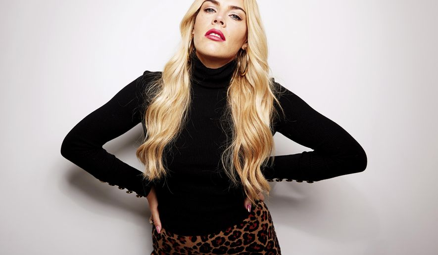 "This Oct. 16, 2018 photo shows actress Busy Philipps posing for a portrait in New York to promote her memoir, ""This Will Only Hurt a Little."" (Photo by Taylor Jewell/Invision/AP)"