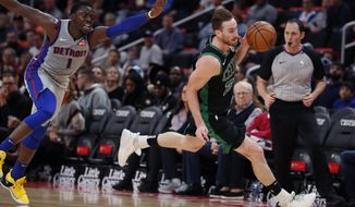 Boston Celtics forward Gordon Hayward (20) steals the ball from Detroit Pistons guard Reggie Jackson (1) during the first half of an NBA basketball game, Saturday, Oct. 27, 2018, in Detroit. (AP Photo/Carlos Osorio)