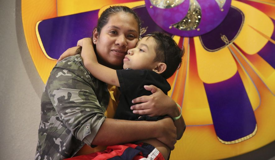 In this Sept. 26, 2018 photo, Julian Morales hugs his mom, Mayra Garcia, in their Homestead, Fla. home.  Julian was diagnosed with Dyskeratosis Congenita, a rare genetic disorder in which the marrow does not produce sufficient blood cells, when he was 3. While he's on a medicine that has stabilized him, there are only a few more years it will work, doctors say.   (Emily Michot /Miami Herald via AP)