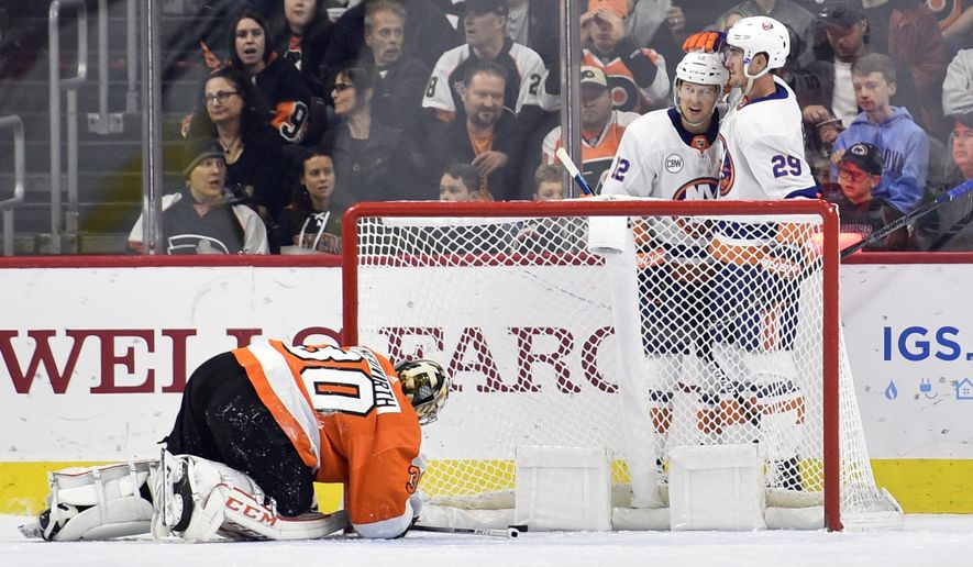 New York Islanders' Brock Nelson, right, celebrates with Josh Bailey after scoring a goal past Philadelphia Flyers goaltender Michal Neuvirth (30) during the second period of an NHL hockey game, Saturday, Oct. 27, 2018, in Philadelphia. (AP Photo/Derik Hamilton)