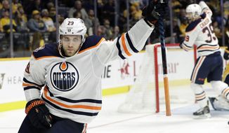 Edmonton Oilers center Leon Draisaitl (29), of Germany, celebrates after scoring a goal against the Nashville Predators in the third period of an NHL hockey game Saturday, Oct. 27, 2018, in Nashville, Tenn. (AP Photo/Mark Humphrey)