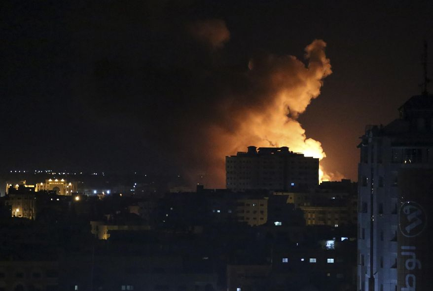 Smoke rises from an explosion caused by an Israeli airstrike on Gaza City, early Saturday, Oct. 27, 2018. Israeli aircraft struck several militant sites across the Gaza Strip early Saturday shortly after militants fired rockets into southern Israel, the Israeli military said. (AP Photo/Adel Hana)