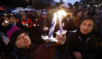 People light candles as they gather for a vigil in the aftermath of a deadly shooting at the Tree of Life Congregation, in the Squirrel Hill neighborhood of Pittsburgh, Saturday, Oct. 27, 2018. (AP Photo/Matt Rourke)
