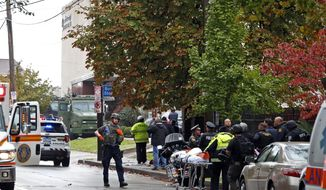 First responders surround the Tree of Life Synagogue in Pittsburgh, Pa., where a shooter opened fire Saturday, Oct. 27, 2018. (AP Photo/Gene J. Puskar)