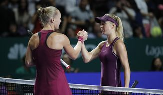 Elina Svitolina of the Ukraine, right, greet by Kiki Bertens of the Netherlands after their women's singles semi final match at the WTA tennis finals in Singapore, Saturday, Oct. 27, 2018. (AP Photo/Vincent Thian)