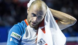 Marius Copil of Romania reacts during his semifinal match against Alexander Zverev of Germany at the Swiss Indoors tennis tournament at the St. Jakobshalle in Basel, Switzerland, on Saturday, Oct. 27, 2018. (Alexandra Wey/Keystone via AP)