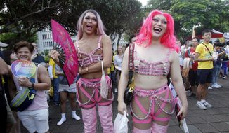Costumed participants pose on a street during the annual gay and lesbian parade, organized by Taiwan LGBT Pride, in Taipei, Taiwan, Saturday, Oct. 27, 2018. (AP Photo/Chiang Ying-ying)