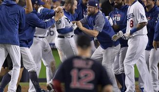 The Los Angeles Dodgers celebrates after Max Muncy's walk off home run during the 18th inning in Game 3 of the World Series baseball game against the Boston Red Sox on Saturday, Oct. 27, 2018, in Los Angeles. The Dodgers won 3-2. (AP Photo/Mark J. Terrill)